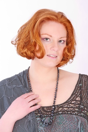 Fashion portrait of a smiling red-haired woman Stock Photo - 10609894