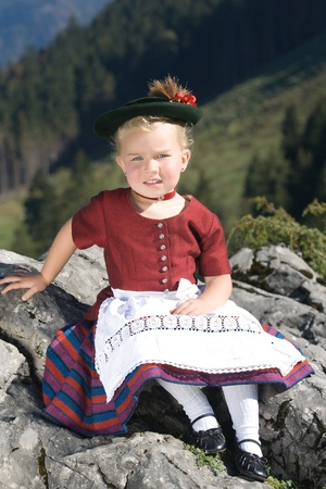 Little blonde girl in typical Bavarian costume on the mountain Stock Photo - 10826101