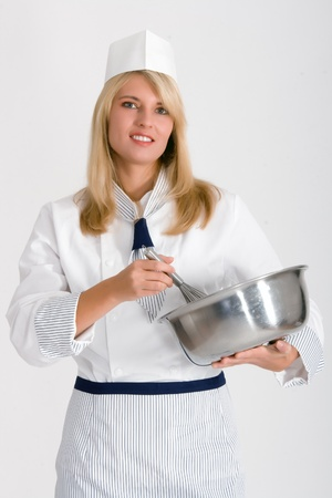 Female baker with a bowl and whisk to stir the dough Stock Photo - 11148236