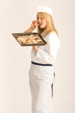 nibbles: Chefs nibbles at your Christmas cookies Stock Photo