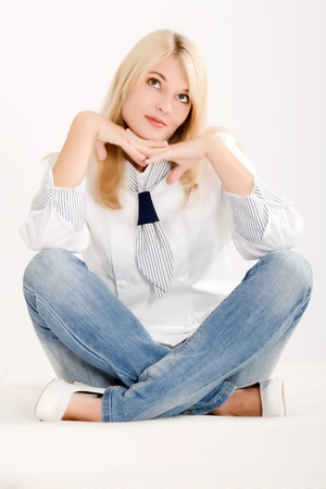 Positive-thinking woman in work clothes sitting on the floor