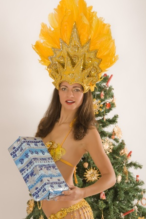 Beautiful samba girls with Christmas parcels from Bavarian Christmas tree photo