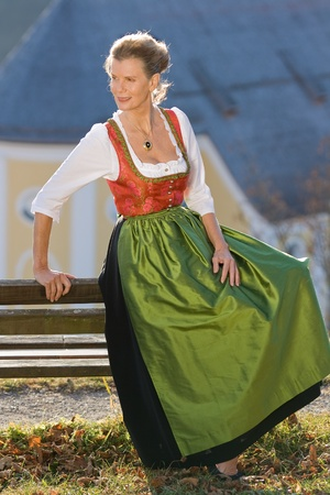 Old Bavarian woman in fashionable festive costume photo