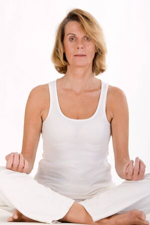 finds: Older lady finds relaxation in yoga Stock Photo