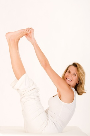 Older lady finds relaxation in yoga and smiles Stock Photo