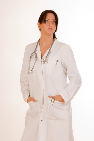 Doctor with stethoscope in white and sexy look photo