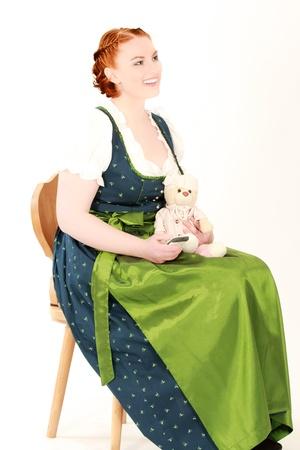 Stitz Bavarian woman with teddy bear on a chair  photo