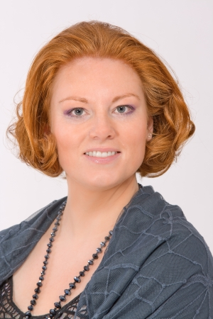 Fashion portrait of a smiling red-haired woman photo