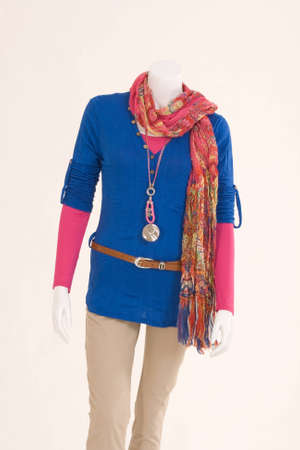 Mannequin dressed in colorful cloth, blue sweater, beige pants and Stock Photo - 12325079