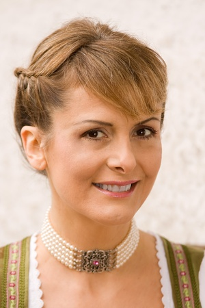 Portrait of a smiling brown-haired woman from Bavaria Necklace photo