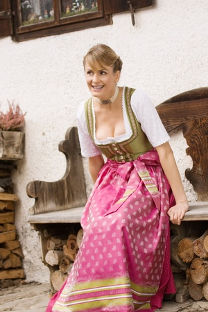Bavarian girls in traditional costume is full of joy and laughter photo