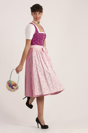 Young woman in Bavarian dress with an Easter basket  photo
