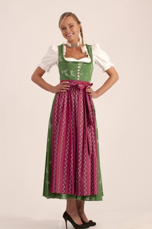 Portrait of a girl in the green Bavarian dirndl  Stock Photo - 13268625
