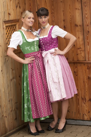 Two girls in Bavarian garb on an alp