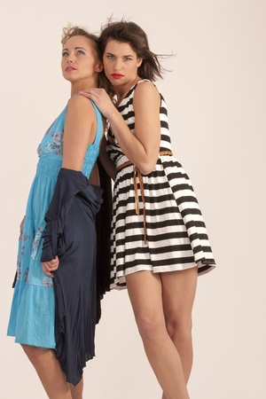 fashionably: two girlfriends are dressed fashionably