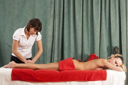 A massage with polished, heated stones  photo