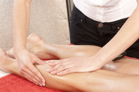 Leg massage with hot stones and oil  photo