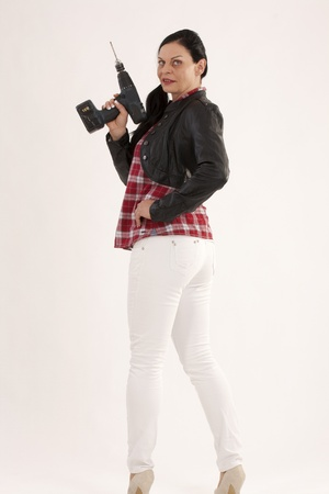 Modern woman with a DIY drill photo