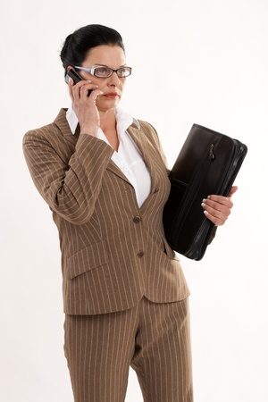 modern business woman on the phone with timer in hand photo