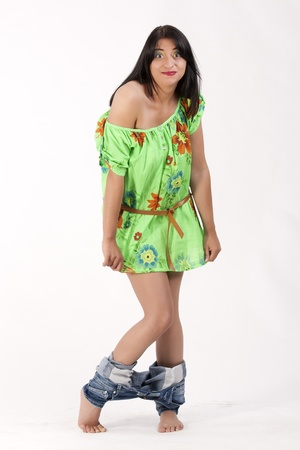 Young woman in a floral tunic with a lowered jeans photo