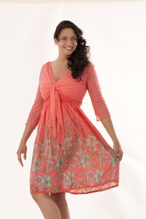 Black-haired woman in a salmon-colored summer dress Stock Photo - 13741359