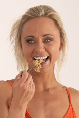 eating noodles: Portrait of a blond woman eating noodles