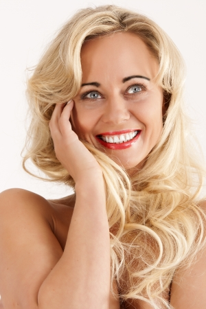 Young woman with a radiant smile and blond hair photo