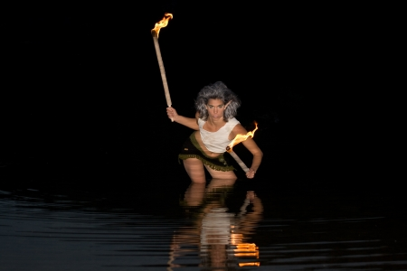 Elf with torches in the water is photo