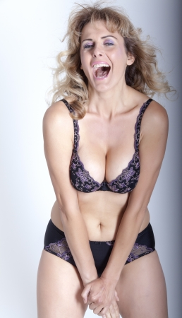 Funny woman with brown hair in black lingerie
