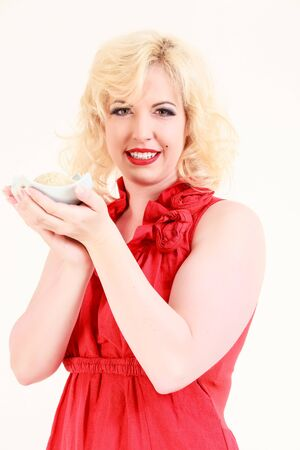 Blonde woman holding a bowl of rice in the hands photo