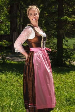 german: Blonde woman in a Bavarian folk costume Stock Photo