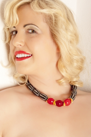 Portrait of a blond woman with a beautiful necklace