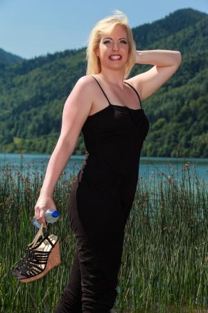 fashionably: blonde woman with oversized lake, dressed fashionably Stock Photo