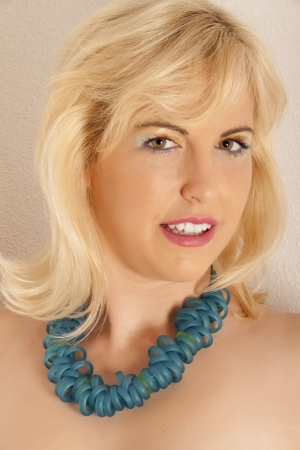Portrait of a blond woman with exclusive jewelery