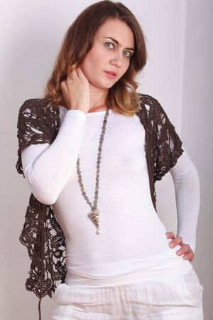 fashionably: Fashionably dressed woman with a designer jewelry around her neck