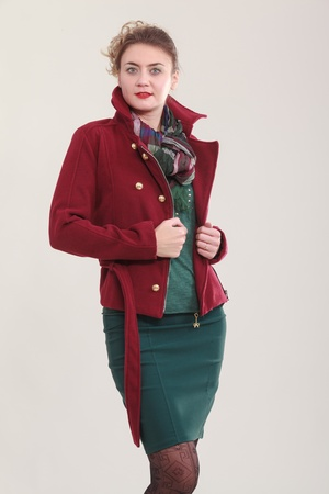 vouge: Elegant business woman with sexy mini skirt and red jacket