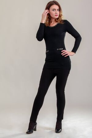 Business woman with fashionable sweater and black pants photo