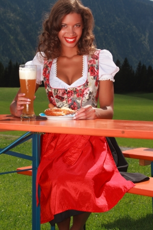 Bavarian girl eat and drink when in costume  photo