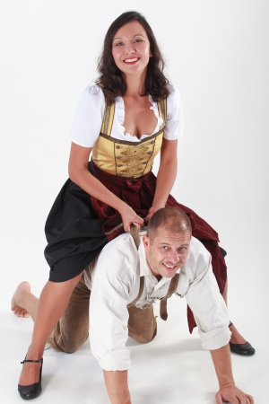 Love couple in Bavarian costume during frisk on the  photo
