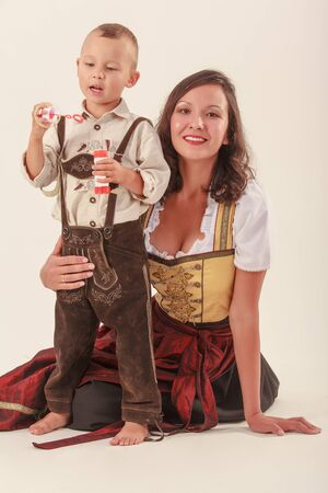 Bavarian mother in costume with your son at play photo