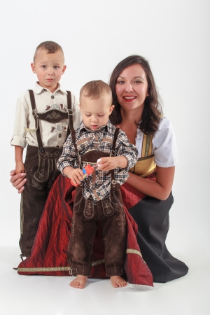 Your mother with two boys in Bavarian costume photo