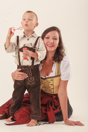 Single mother with her son in Bavarian costume photo
