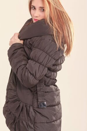 Attractive girl in a warm quilted coat  photo