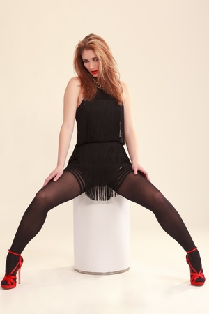 Young woman in mini dress and elegant tights  photo