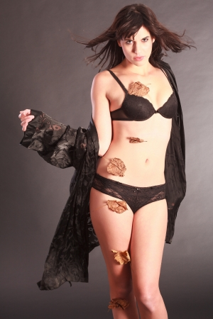 Woman in black lingerie and leaves the body photo