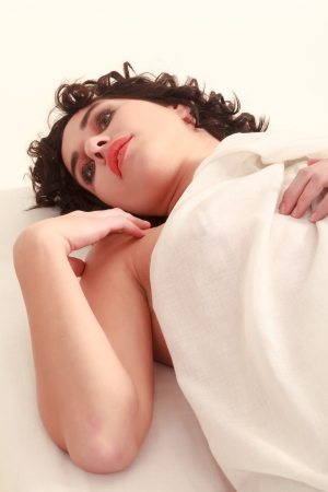 Young woman lying nude in bed dreaming Stock Photo - 18208911