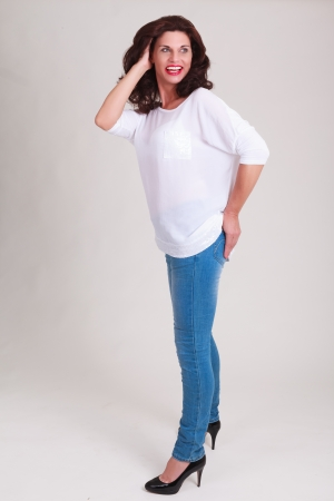 snort: laughing senior model in fashionable jeans with a white blouse