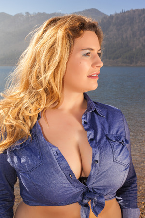 breasts: Beautiful portrait of a young woman with large breasts and long blond hair, with deep Dekollette  Stock Photo