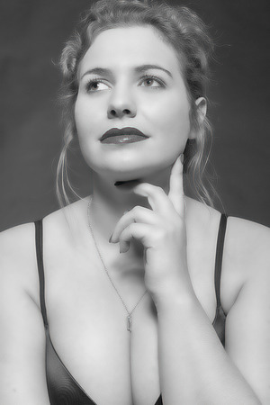 Black   white portrait of a friendly-looking model in oversized with big breasts in a black bra Banco de Imagens