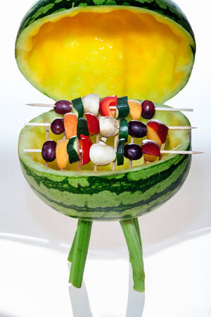 Grill watermelon with rust and covered with fruit skewers